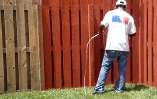 paint spraying a fence